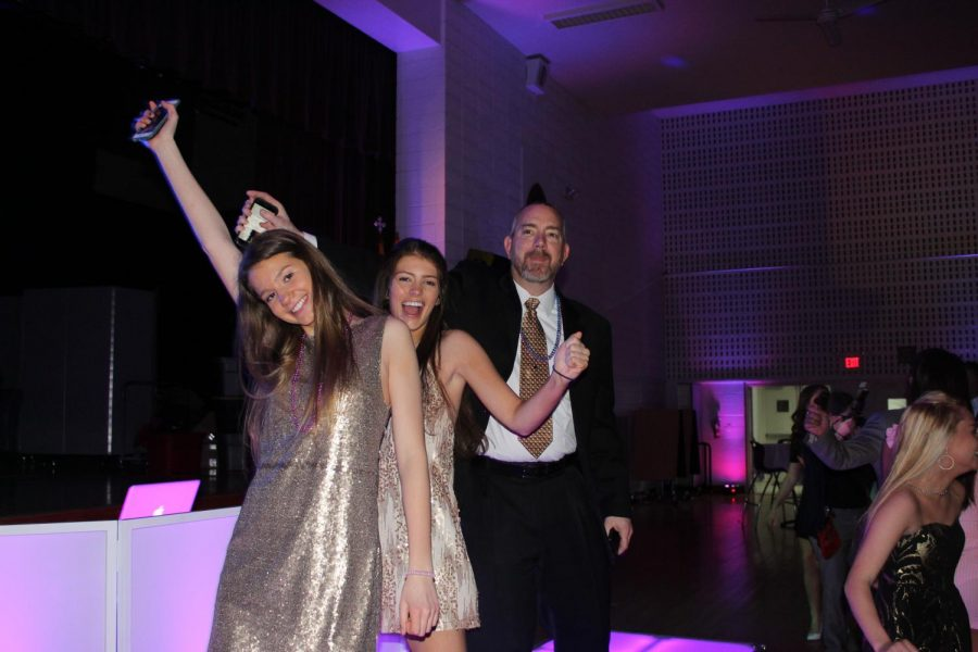 Abby Akers '19 and Maddie Akers '22 having fun with their dad at the FDD.