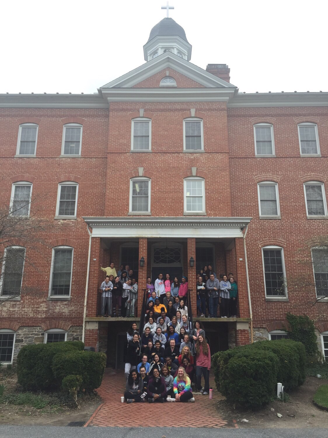 The Kairos 87 group takes one last group photo before departing to return to school.