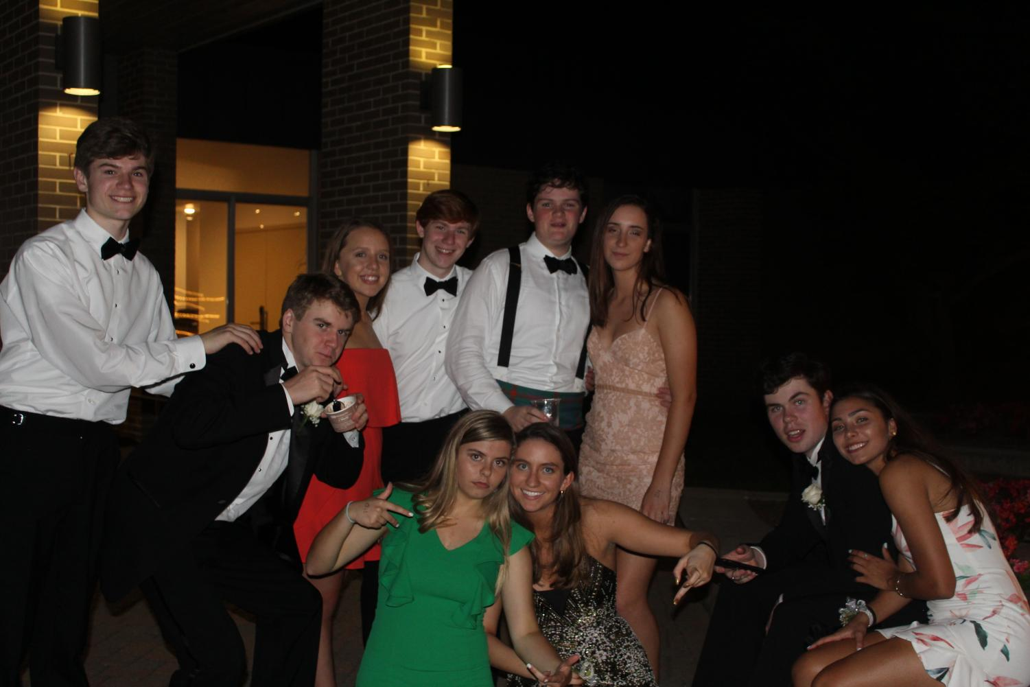 Juniors pose with their dates while they enjoy the ice cream sundaes in the courtyard.