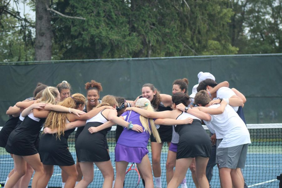 Varsity+tennis+team+getting+pumped+up+with+a+cheer+before+their+match.