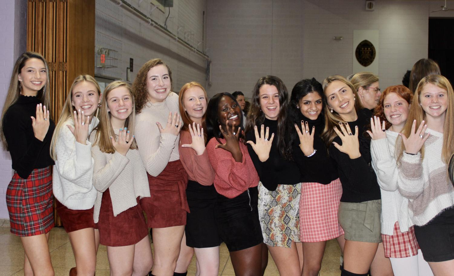 Juniors showing off their new class rings