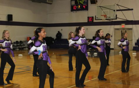Poms team performing in the AHC gym
