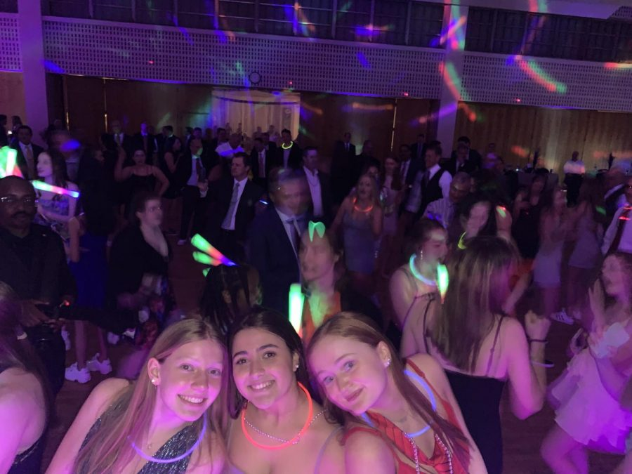 Sophomores smiling on the FDD dance floor.