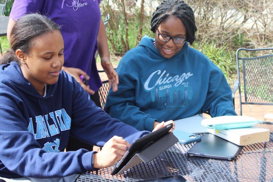 Seniors Jackie Adedokun and Mari Greene use their free period to study together in the senior courtyard.