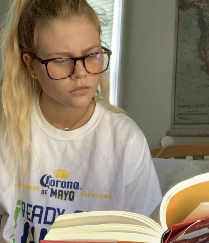 Junior Cassie Fredell fills newfound free time due to COVID-19 with productive activities that help benefit her mental health, including reading.