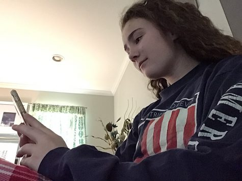 Junior Eileen McConville using social media while at home to remain connected with friends.