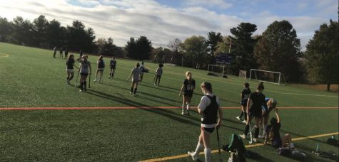 Field Hockey team practices safely.