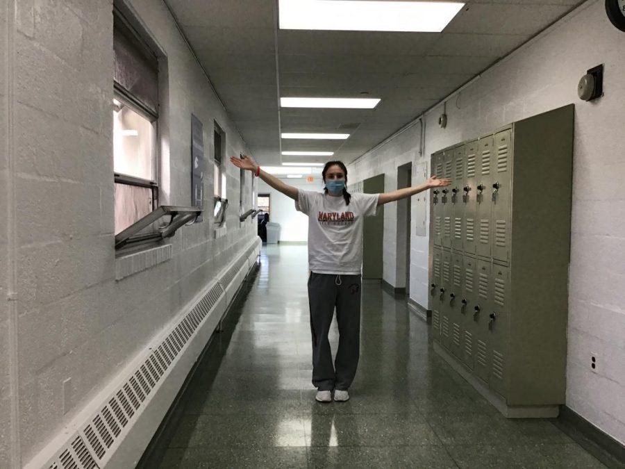 Senior+Megan+Locraft+stands+in+the+empty+hallways.+