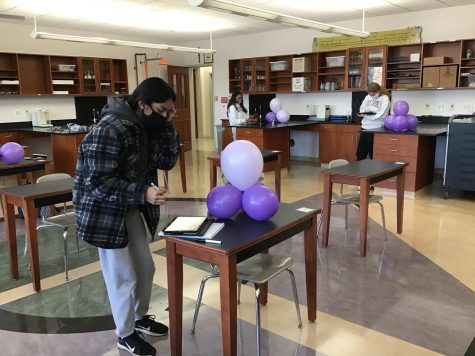 Sophomores completing a balloon atom lab.
