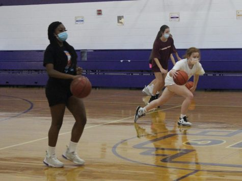 Students practicing basketball
