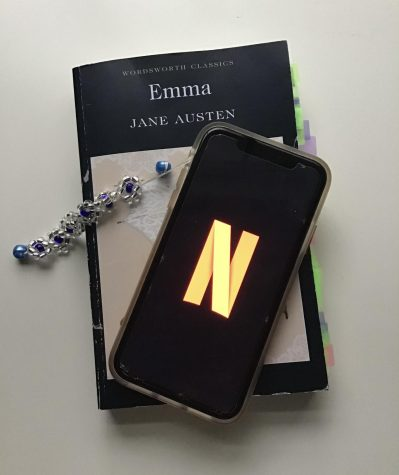 A phone with the Netflix logo and a book.