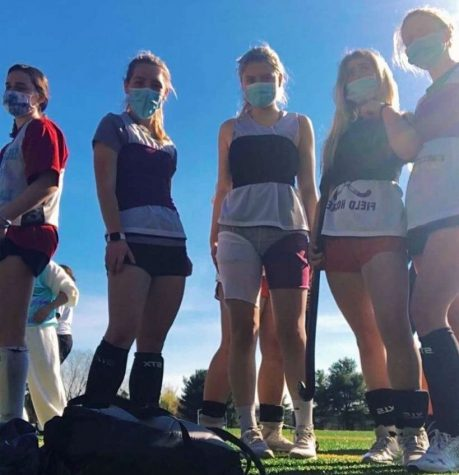 Some AHC field hockey players using the mask given as tube tops, while wearing their actual masks.
