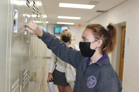Student opening her locker
